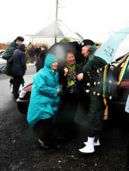 20070317-021-ie-achill-stpatsdayparade-trying_to_shelter-w